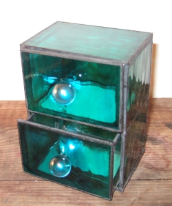 Sea green glass chest of drawers